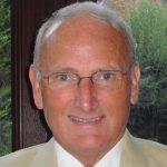 A headshot of Deputy Lieutenant of Essex Charles Clark OBE QPM DL BA (Hons) MBA